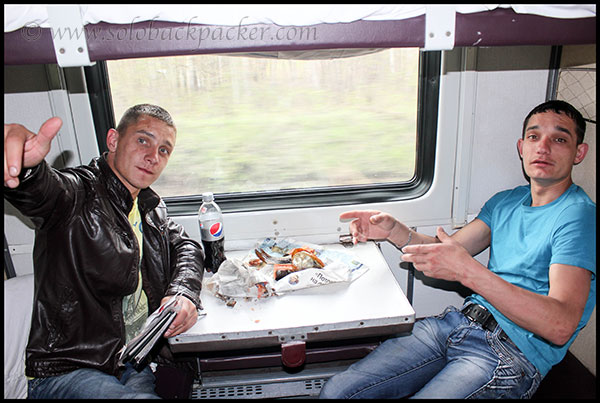 Travellers Enjoying Local Fish On-Board A Train