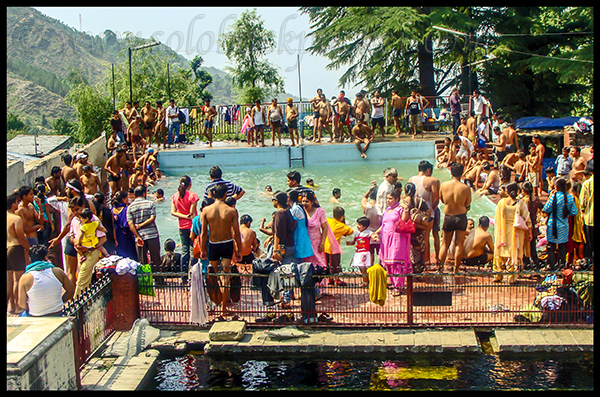 Tourists Bathing In Front of Bhagsu Nag Temple
